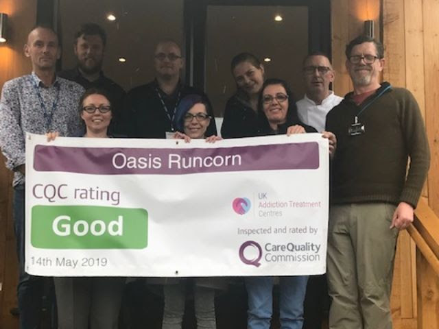 the oasis runcorn team holding cqc result banner